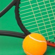 Tennis racket and a ball — Stock Photo #5766140