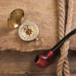 Compass and a pipe with a rope — Stock Photo #6103717