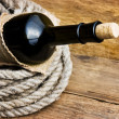 Stock Photo: Bottle wrapped with rope