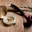 Stock Photo: Compass and a pipe with a rope