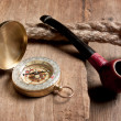 Compass and a pipe with a rope — Stock Photo #6252588