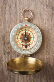 Compass on the background of the wooden planks — Stock Photo
