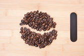 Coffee beans on the board — Stock Photo