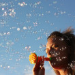 Girl blow bubbles — Stock Photo