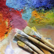 Oil paints palette and paint brushes - Stock Photo