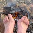 Bare Feet warming at a Campfire — Stock Photo