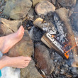 Bare Feet warming at a Campfire in winter — Stock Photo