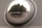 Cityscape reflection in metal sphere facade detail — Stock Photo