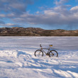 Royalty-Free Stock Photo: Bike on frozen Lake Laberge, Yukon, Canada