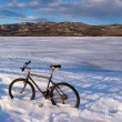 Bike on frozen Lake Laberge, Yukon, Canada — Stock Photo