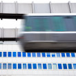 Sky-Train passing fast in front of office building — Stock Photo #5863991