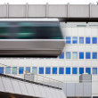 Sky-Train passing fast in front of office building — Stock Photo #5863992