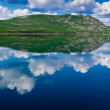 Stock Photo: Yukon wilderness reflected on calm lake