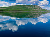 Yukon wilderness reflected on calm lake — Stock Photo