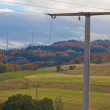 Power line and wind turbines — Stock Photo