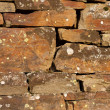 Weathered stone wall background - Foto Stock