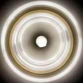 Glowing bulb in lamp shade — Stock Photo