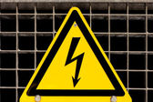 High Voltage Sign bolted on steel grid — Stock Photo
