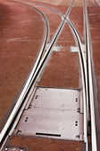 Tram rails and switch in pavement of city street — Stock Photo