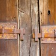 Rusty locks on wood background — Stock Photo