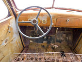 Inside cab view of rusty old junked pickup truck — Stock Photo