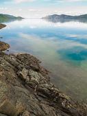 Lake Laberge, Yukon T, Canada, on calm summer day — Stock Photo