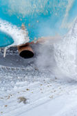 Vehicle exhaust pipe in winter — Stock Photo