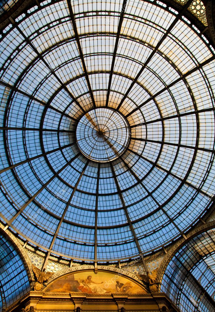 The Galleria Vittorio Emanuele II is a covered double arcade formed of two glass-vaulted arcades at right angles intersecting in an octagon, prominently sited o — Stock Photo #6376556