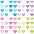 Seamless pattern with colored sets of hearts — Stock Photo #5446965