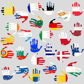 Hands with European Union countries flags — Stock Photo