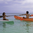 Couple with kayak and paddle board — Stock Photo