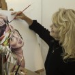 Artist in her fifties painting — Stock Photo #5627797