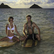 Newlywed couple on their surfboards in hawaii — Foto Stock
