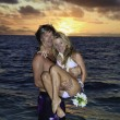 Newlywed couple in their forties in the ocean — Foto de Stock