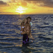 Newlywed couple in their forties in the ocean — Стоковая фотография