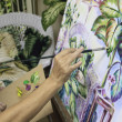 Artist in her fifties painting a still life — Stock Photo #6167692