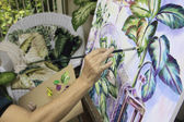 Artist in her fifties painting a still life — Stock Photo