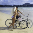 Newlywed couple on the beach with their bicycles — Stock Photo #6281803