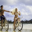 Newlywed couple on the beach with their bicycles — Stock Photo #6281834