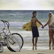 Newlywed couple at the beach — Stock Photo