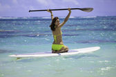Young woman on a standup paddle board — Stock Photo