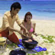 Foto Stock: Couple having barbecue