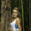 Teenage girl in a bamboo forest — Stockfoto