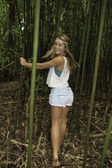 Teenage girl in a bamboo forest — Stock Photo