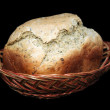 Loaf of bread in basket. — Stock Photo