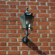 Lantern Attached To A Brick Wall — Stock Photo