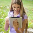 Beautiful Woman With Tablet Computer In Park — Stock Photo #6279698