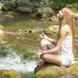 Stock Photo: Beautiful Woman Practive Yoga On River In Nature