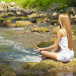 beautiful woman practive yoga on river in nature — Stock Photo