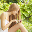 Beautiful Woman With Tablet Computer In Park Garden — Stock Photo